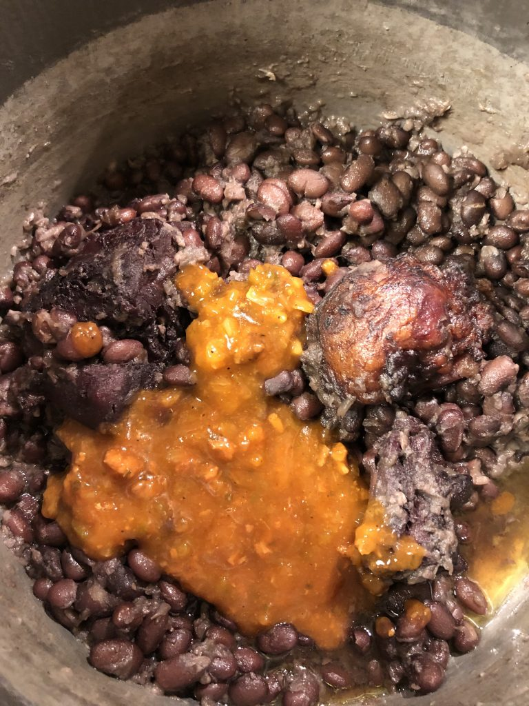 Cooked black beans and ham hock with sofrito