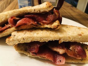 Bacon Sarnie with HP Sauce and Heinz Tomato Ketchup in the background