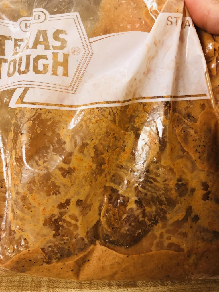 Chicken and marinade in a large plastic resealable bag