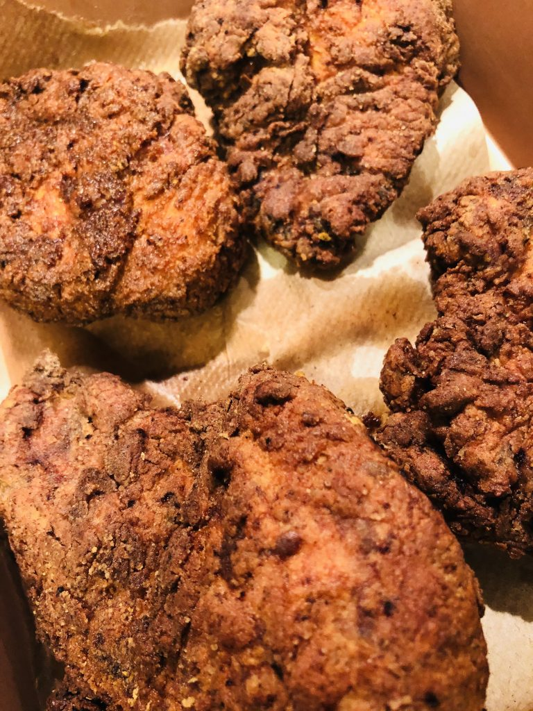 Fried Chicken draining on paper towels