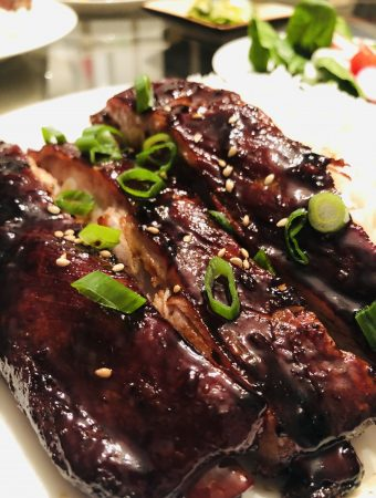 Chinese BBQ Spareribs garnished with green onions
