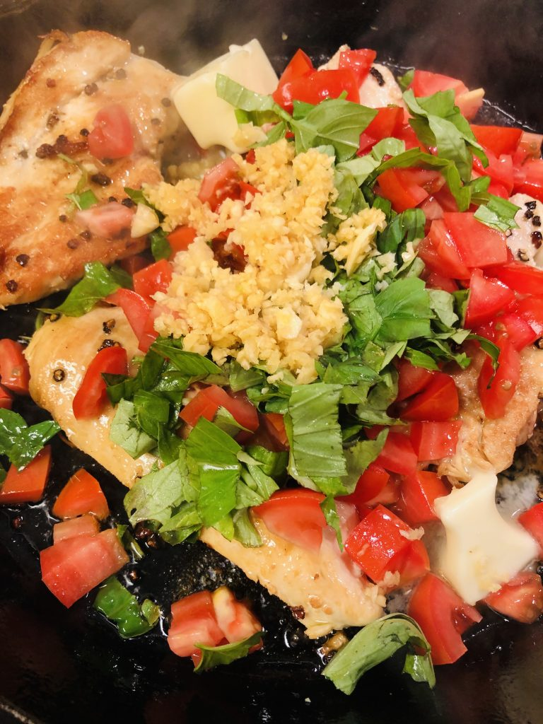 Chicken breasts with garlic, basil, tomatoes