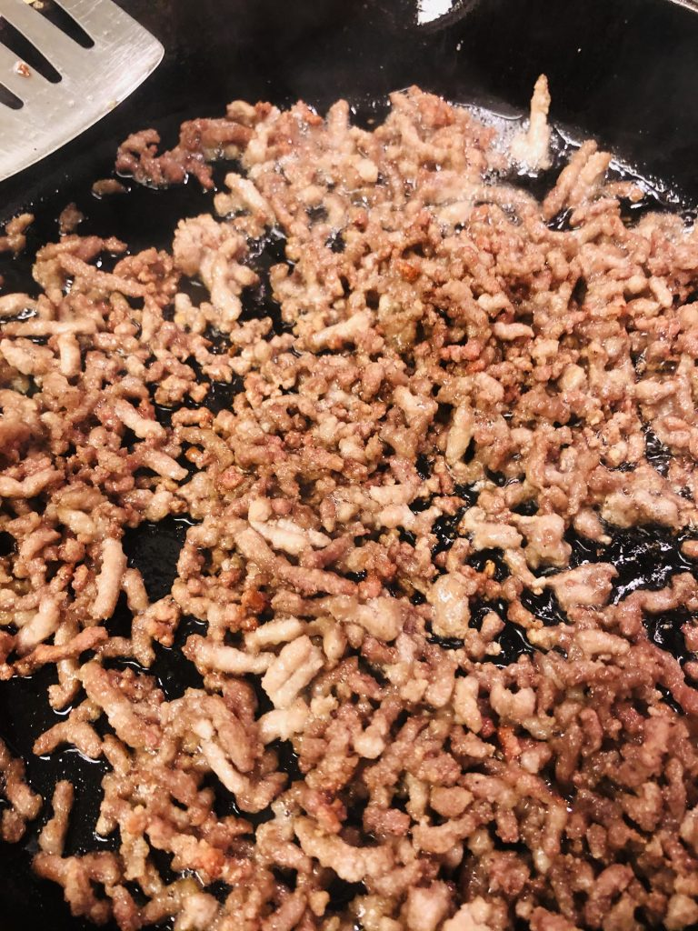 Ground pork cooked until crispy in a cast iron pan