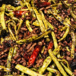 Chinese Long Beans With Pork in a cast iron skillet
