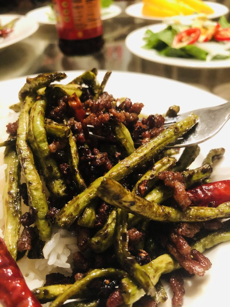 Chinese Long Beans With Pork in a white bowl
