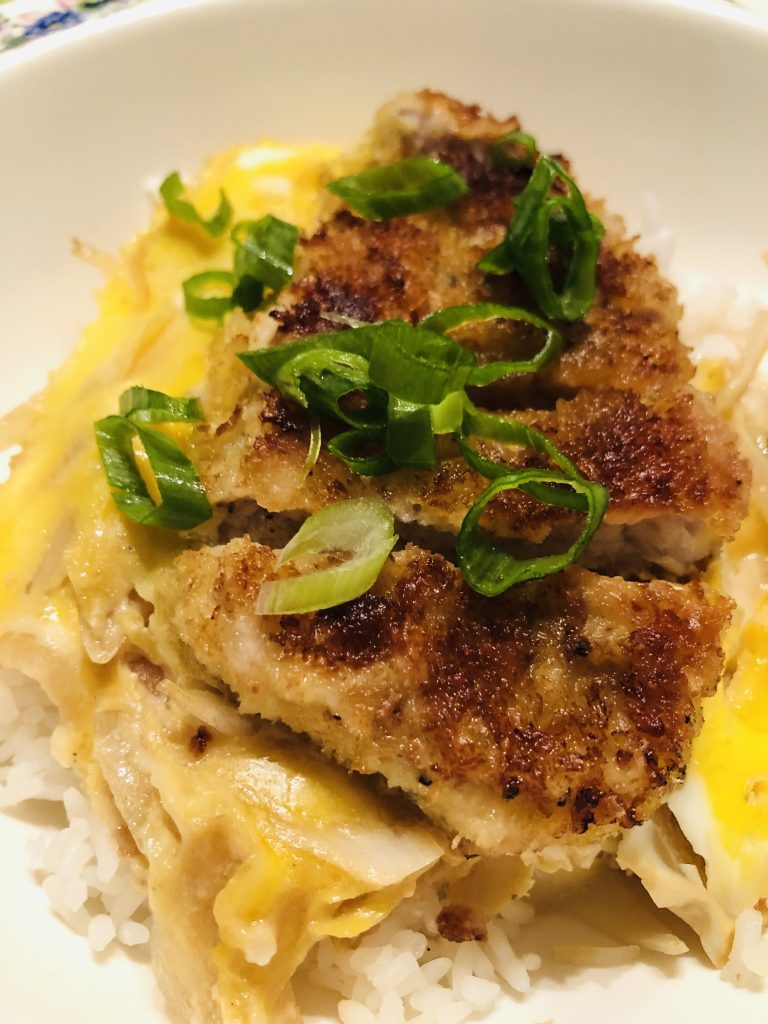 Japanese Pork Katsudon and Rice Bowl garnished with green onions