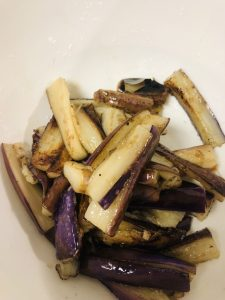 pieces of eggplant which have been stir fried in a white bowl