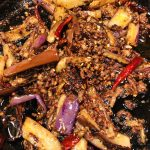 Sichuan Eggplant in a cast iron pan