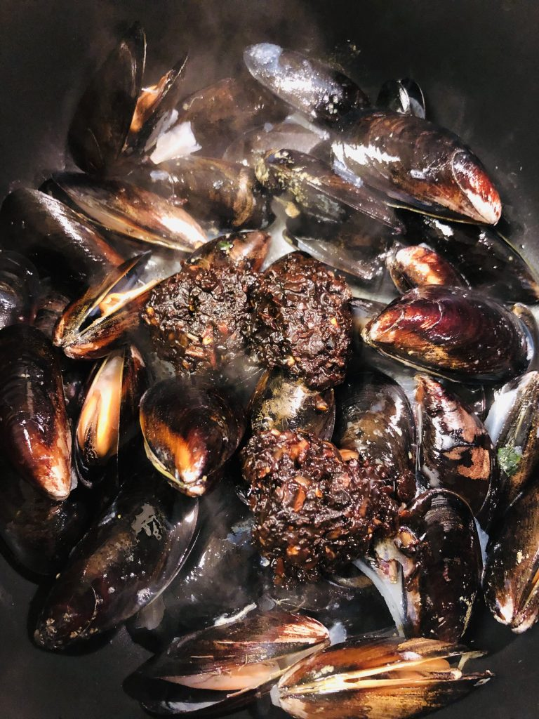 Mussels With Black Bean Sauce in a saucepan