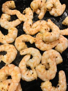 Cooked shrimp in a cast iron pan